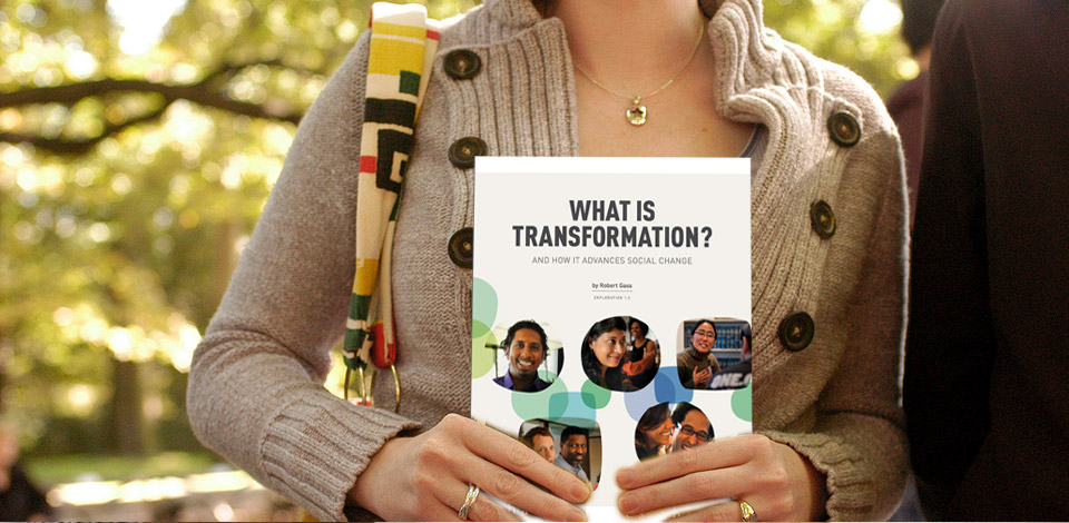 woman holding paper copy of What is transformation